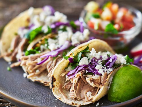 bigstock-Street-tacos-with-carnitas-225381346.jpg